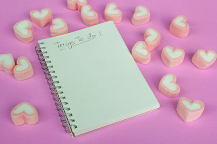 91515022 - marshmallow heart shape with love concept on pink background
